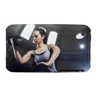 Young woman exercising with dumbbell iPhone 3 case