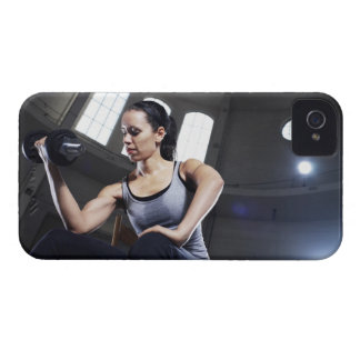 Young woman exercising with dumbbell iPhone 4 case