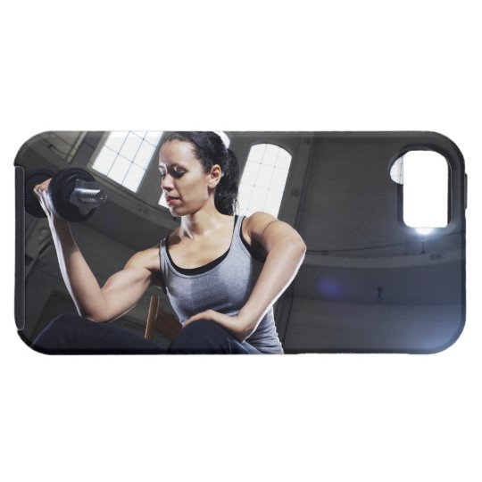 Young woman exercising with dumbbell iPhone SE/5/5s case