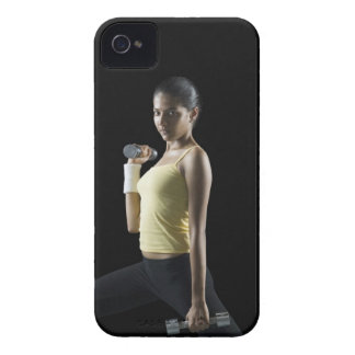 Young woman exercising with dumbbells iPhone 4 cover