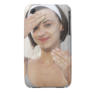 Young woman exfoliating face, smiling, portrait, iPhone 3 cover