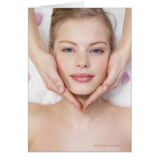 Young woman getting massage greeting cards