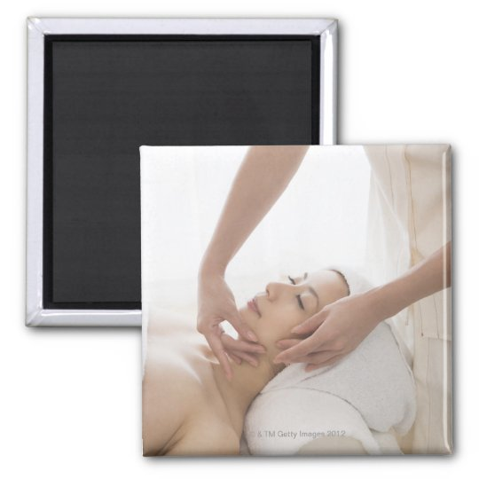 Young woman having facial massage magnet