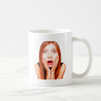 young-woman-holding-cheeks-in-surprise coffee mug