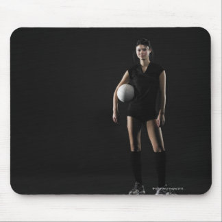 Young woman holding volleyball, portrait mouse pad