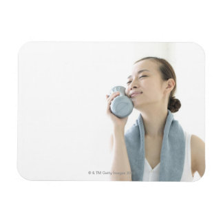 young woman holding water bottle to face rectangular photo magnet