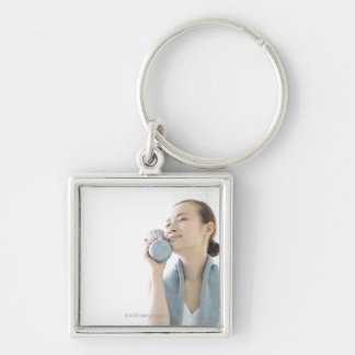 young woman holding water bottle to face Silver-Colored square keychain