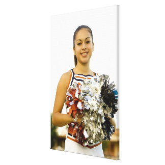 Young woman in cheerleading uniform canvas print