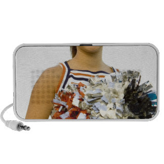 Young woman in cheerleading uniform portable speakers
