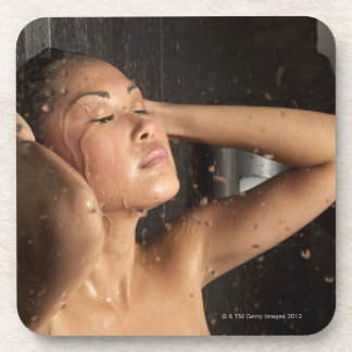 Young woman in shower beverage coaster