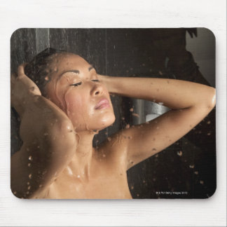 Young woman in shower mouse pads