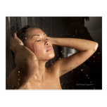 Young woman in shower post card