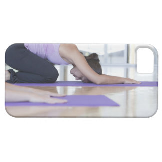 young woman in the downward dog position during iPhone SE/5/5s case
