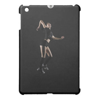 Young woman jumping to hit volleyball, side view iPad mini case