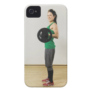 Young woman lifting a barbell. iPhone 4 Case-Mate case