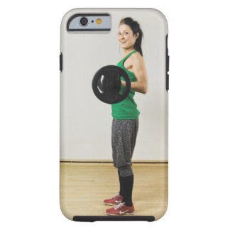 Young woman lifting a barbell. tough iPhone 6 case
