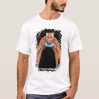 Young woman lifting barbell, portrait T-Shirt