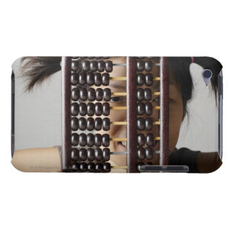 Young woman peering through abacus. Case-Mate iPod touch case