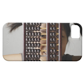 Young woman peering through abacus. iPhone SE/5/5s case