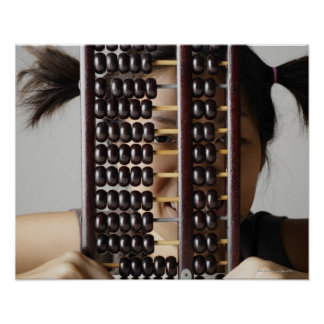 Young woman peering through abacus. poster