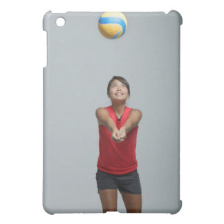 Young woman playing with volleyball iPad mini cover