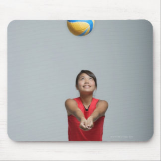 Young woman playing with volleyball mouse pad