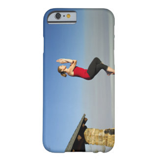 young woman practices yoga on a bluff in the barely there iPhone 6 case