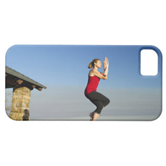 young woman practices yoga on a bluff in the iPhone SE/5/5s case