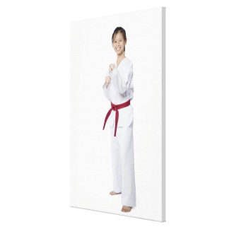 Young woman practicing karate and smiling gallery wrap canvas