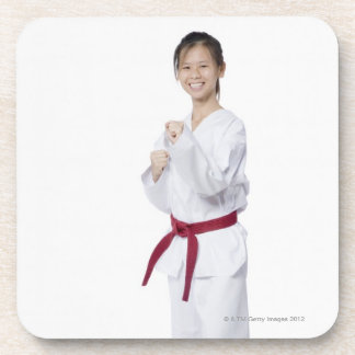 Young woman practicing karate and smiling drink coaster