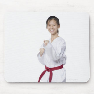 Young woman practicing karate and smiling mouse pad