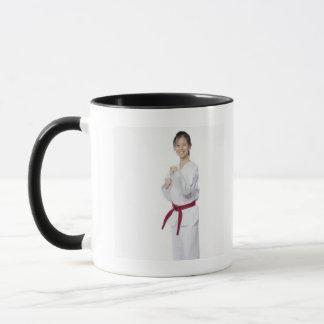 Young woman practicing karate and smiling mug