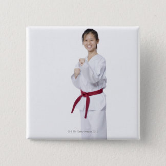 Young woman practicing karate and smiling pinback button