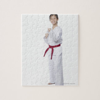 Young woman practicing karate and smiling puzzle