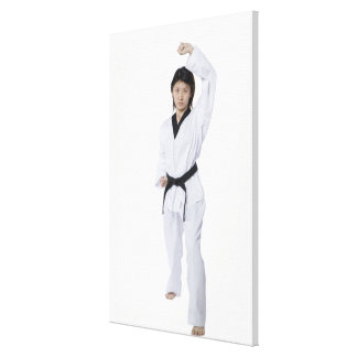 Young woman practicing upper block stretched canvas prints