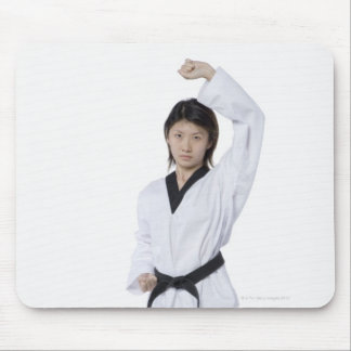Young woman practicing upper block mouse pad