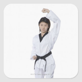 Young woman practicing upper block square sticker