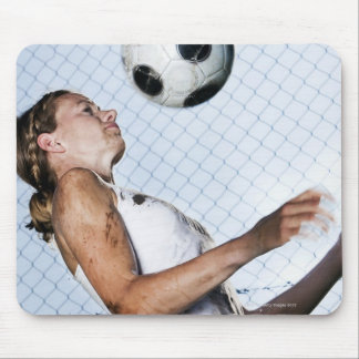 young woman practising with football mouse pad