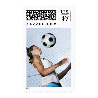 young woman practising with football postage stamp