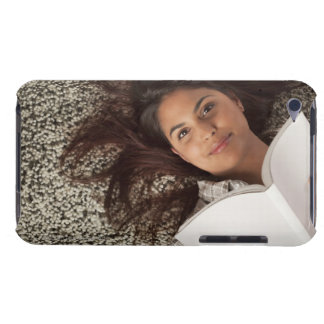Young woman reading a book lying down Case-Mate iPod touch case