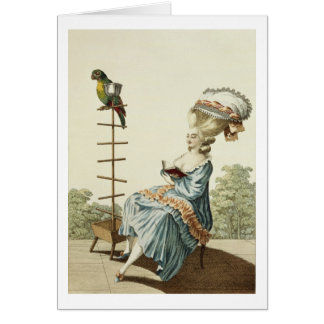Young woman reading in a day dress with an elabora card