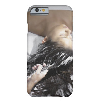 Young woman receiving hair treatment barely there iPhone 6 case