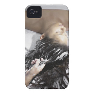 Young woman receiving hair treatment iPhone 4 case