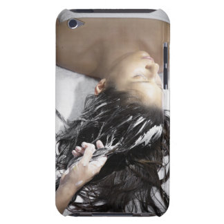 Young woman receiving hair treatment iPod Case-Mate case