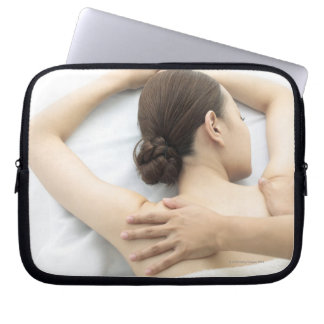young woman receiving massage,woman in health 2 laptop computer sleeve