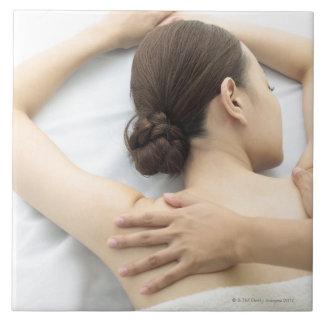 young woman receiving massage,woman in health 2 large square tile