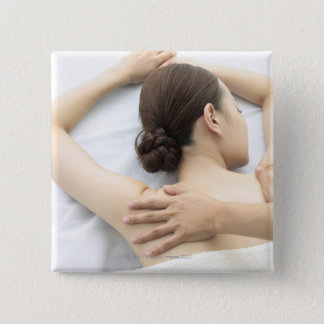 young woman receiving massage,woman in health 2 pinback button