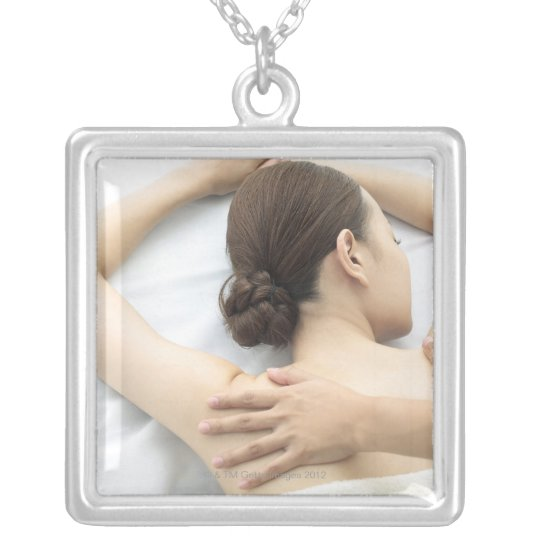 young woman receiving massage,woman in health 2 silver plated necklace