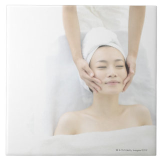 young woman receiving massage,woman in health large square tile
