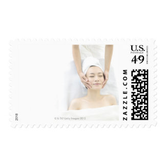 young woman receiving massage,woman in health postage stamp